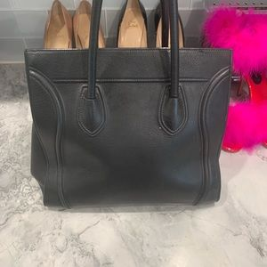 Celine Bags - Authentic all black leather Celine luggage tote.